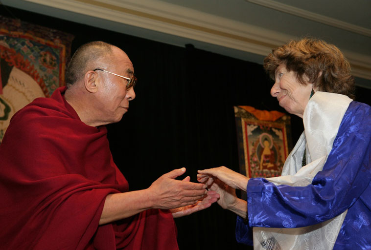 Accepting an award from the Dalai Lama
